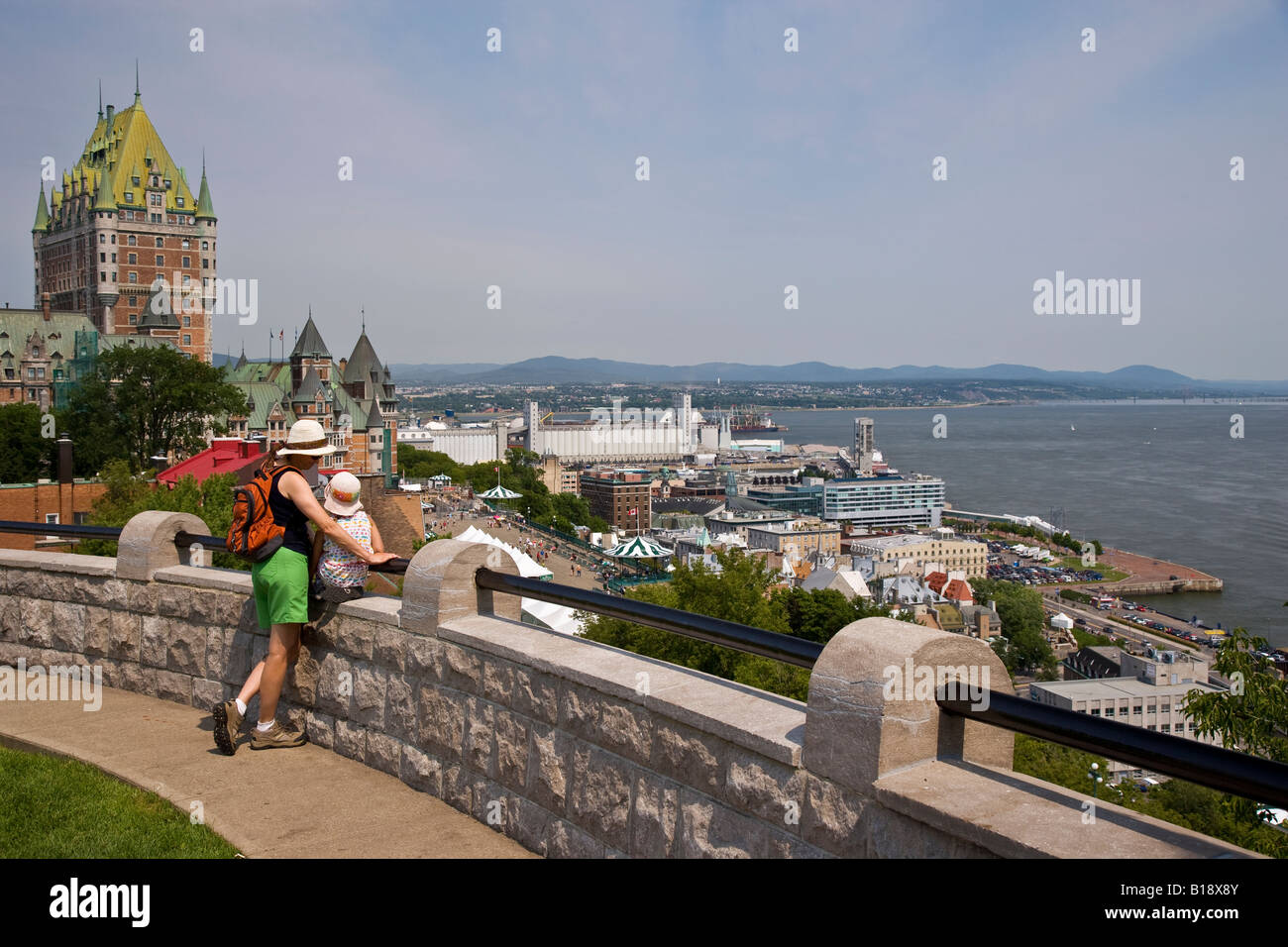Young mother and daughter enjoy view of Quebec City and St Lawrence River from Citadelle, Quebec, Canada. - Stock Image