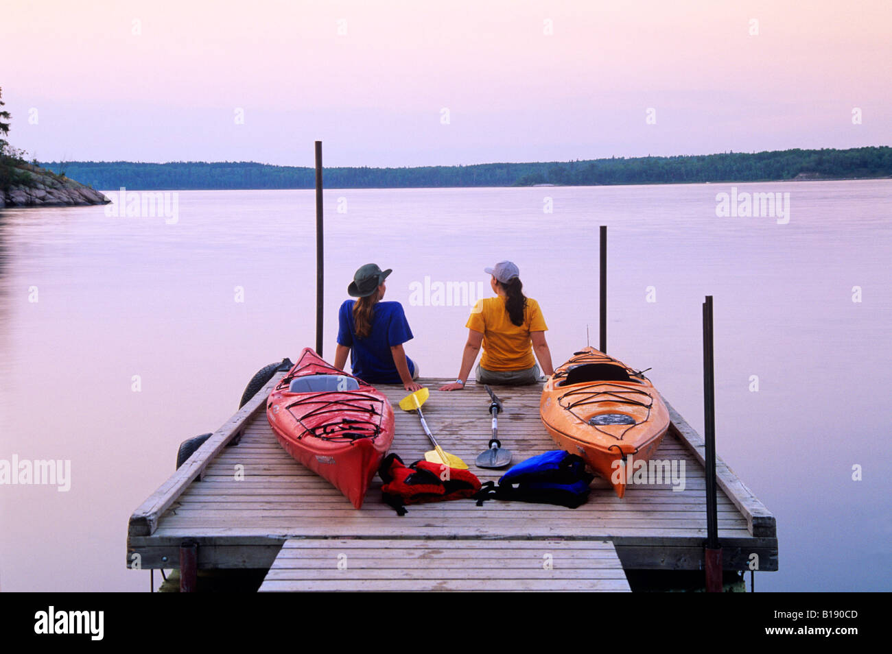 Kayakers an Nutimik Lake campground boat dock, Whiteshell Provincial Park, Manitoba, Canada. - Stock Image