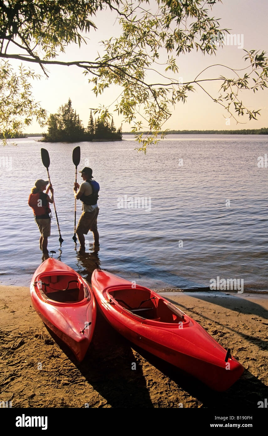 Couple With Kayaks Otter Falls Whiteshell Provincial Park Stock