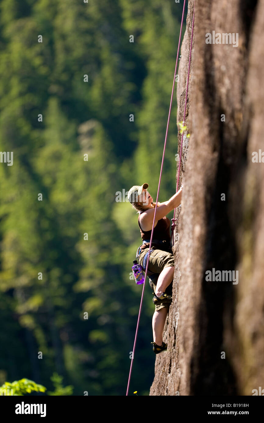 Female rock climber on Red Earth (5.9) Main Wall Crest Craigs in Strathcona Park.  Vancouver Island, British Columbia, - Stock Image