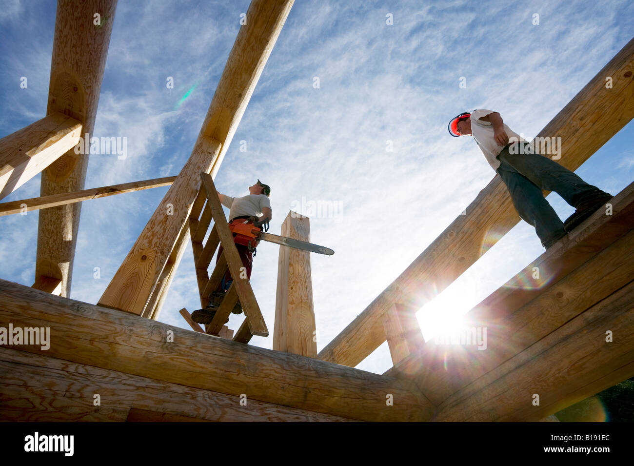 First Nations carpenter's hand framing a cabin roof for export.  Courtenay, Vancouver Island, British Columbia, - Stock Image