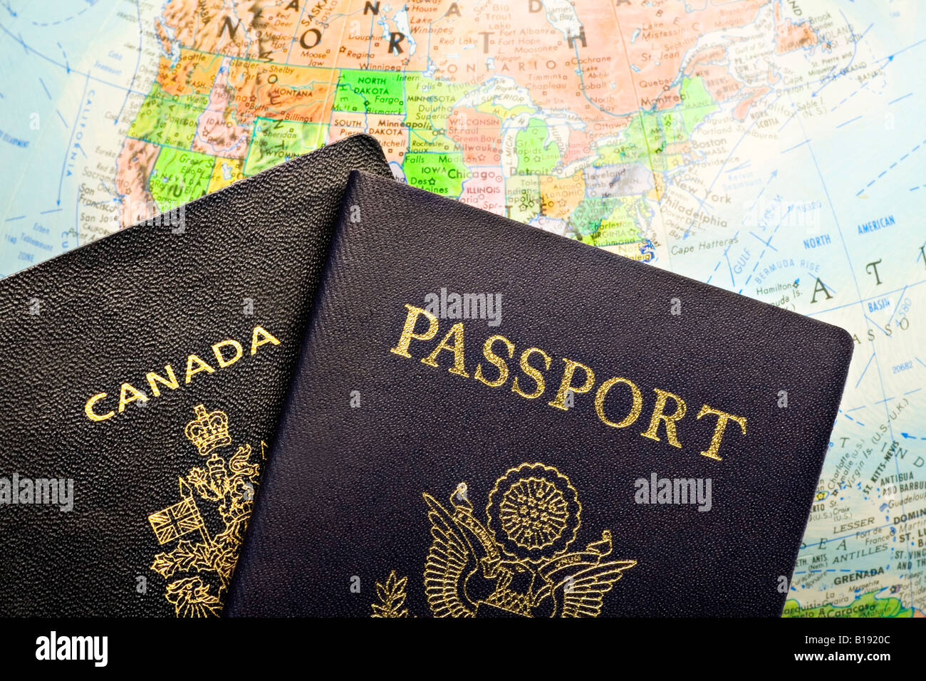 Passports laid over a map of North America - Stock Image