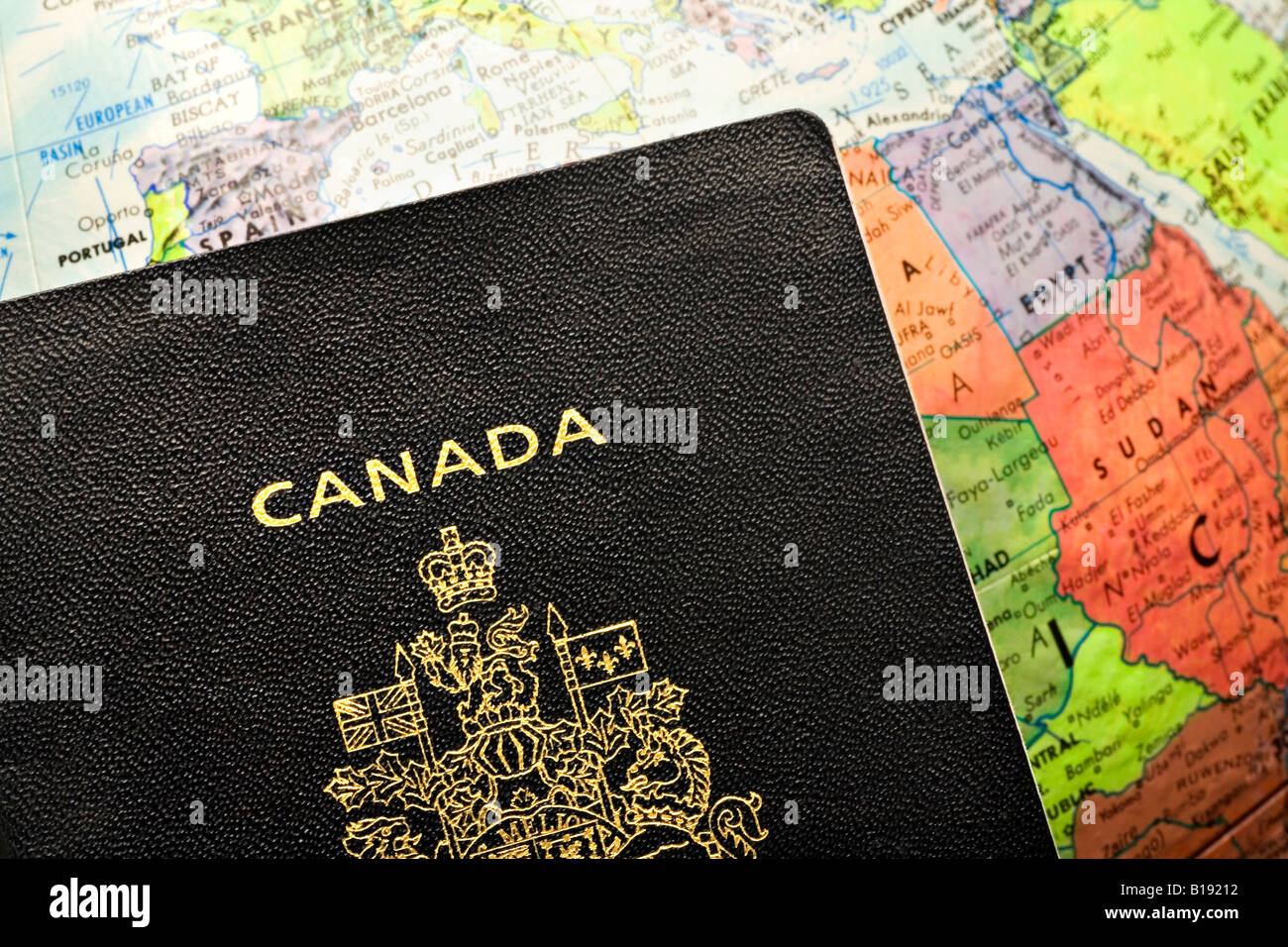 Canadian passport laid over a map of Africa - Stock Image