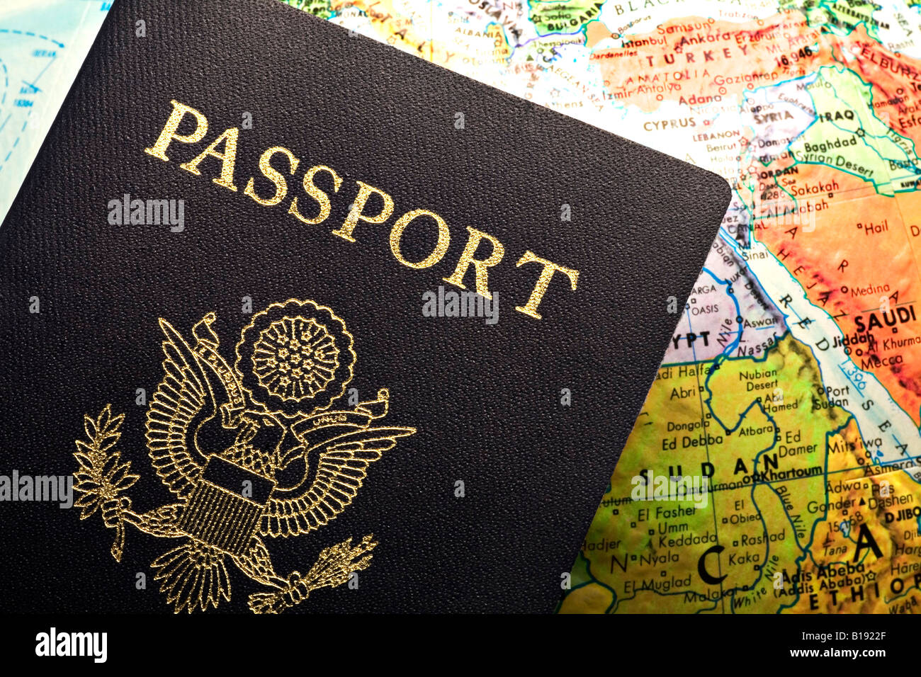 American Passport laid over a map - Stock Image