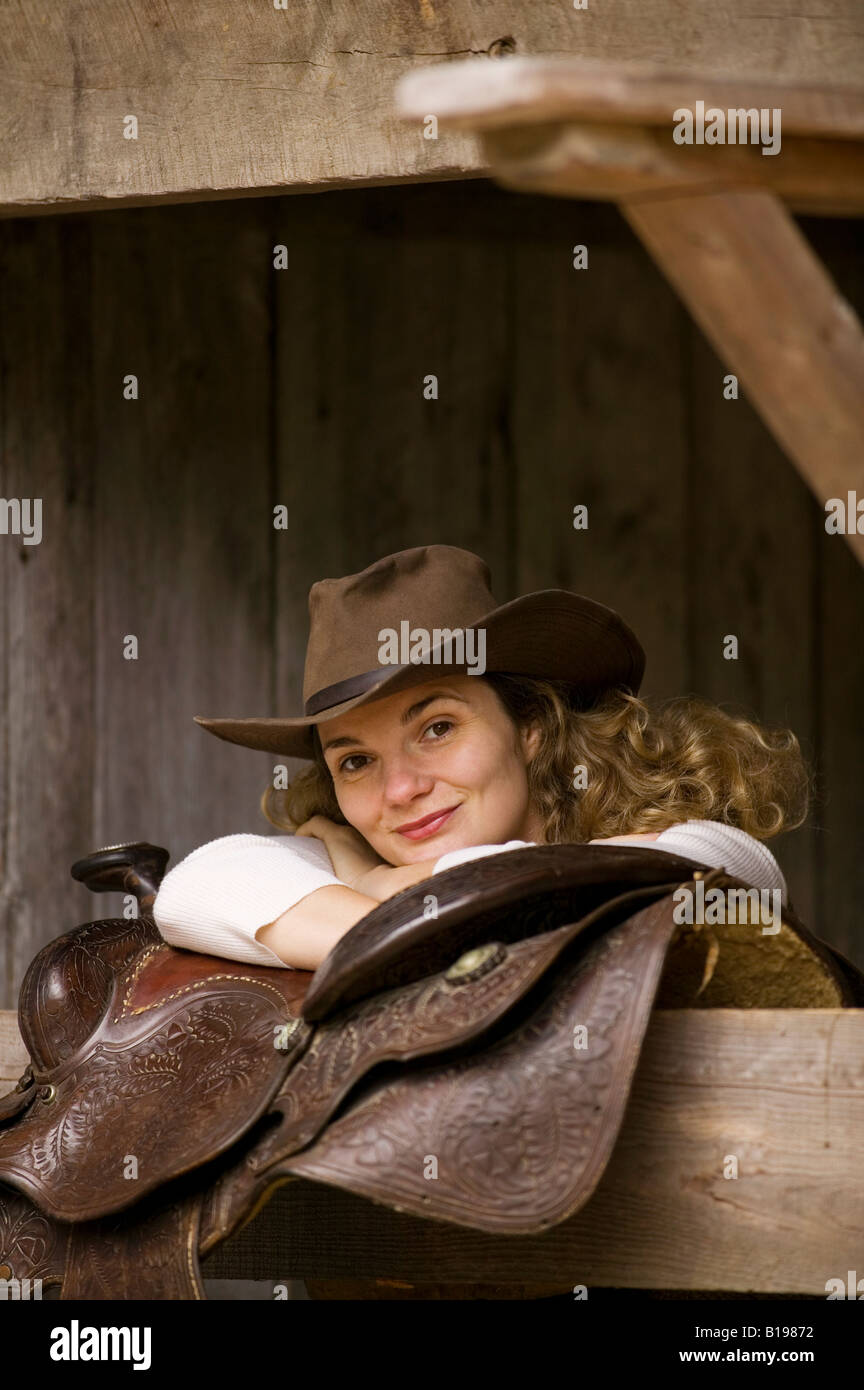 thirty-one year old blond woman wearing a cowboy hat and horse Stock ... f83dd405d3c