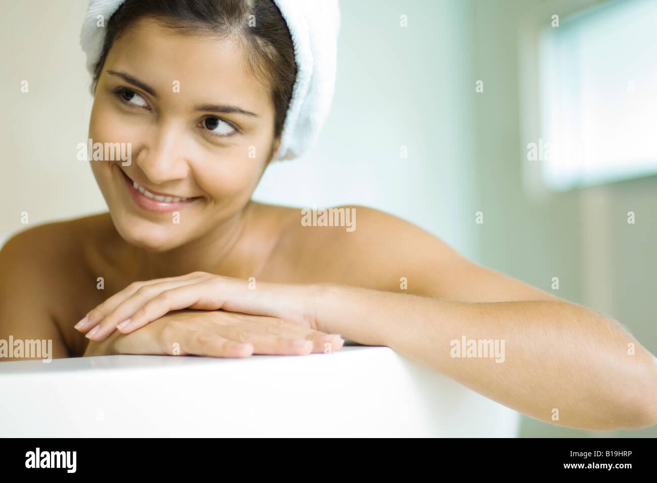 Woman in bathtub, wearing shower cap, smiling Stock Photo: 18036586 ...