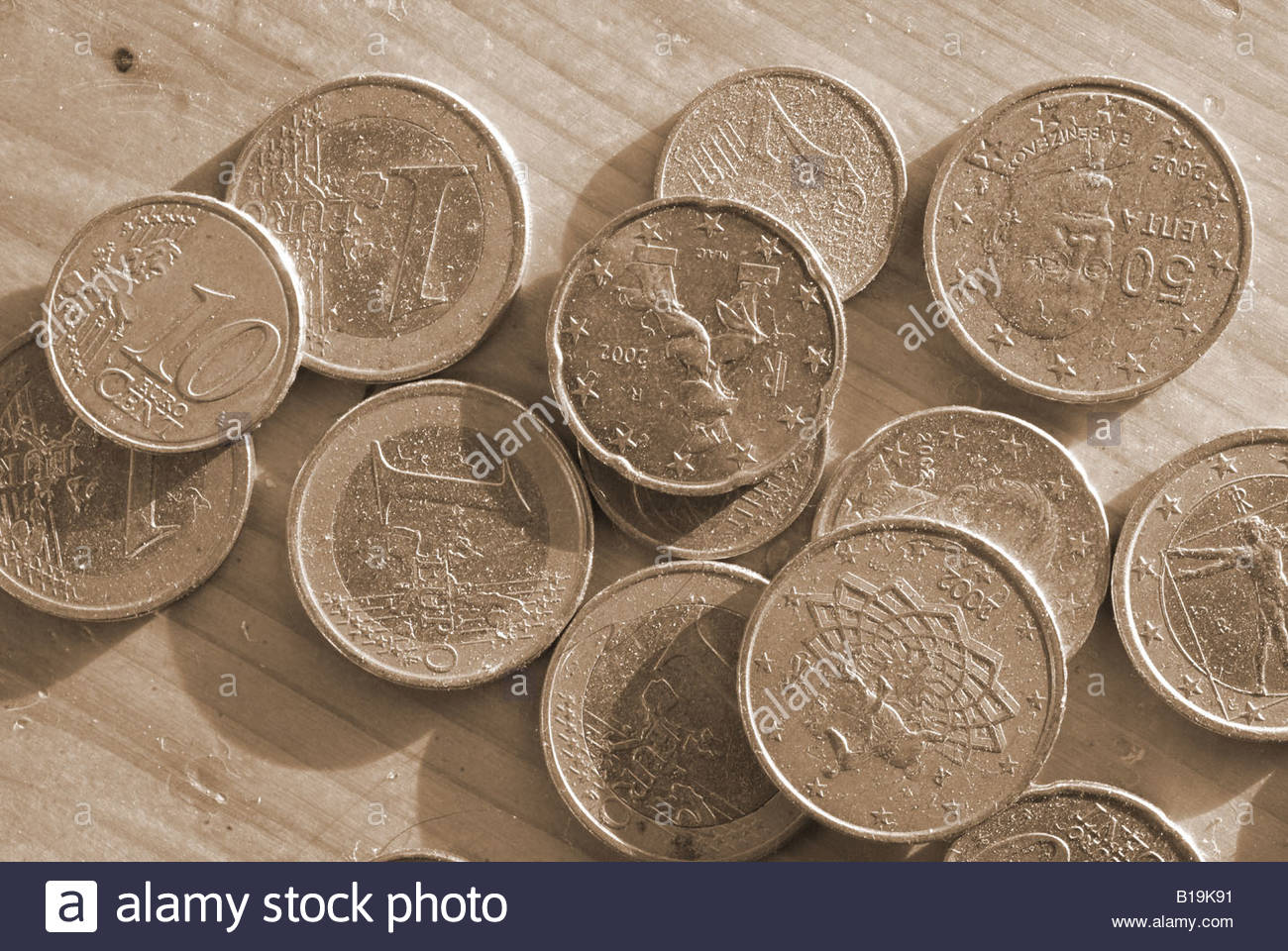 Euro coins euros money currency change Detail close up closeup bold Europe EC EEC Sepia black and white monochrome - Stock Image