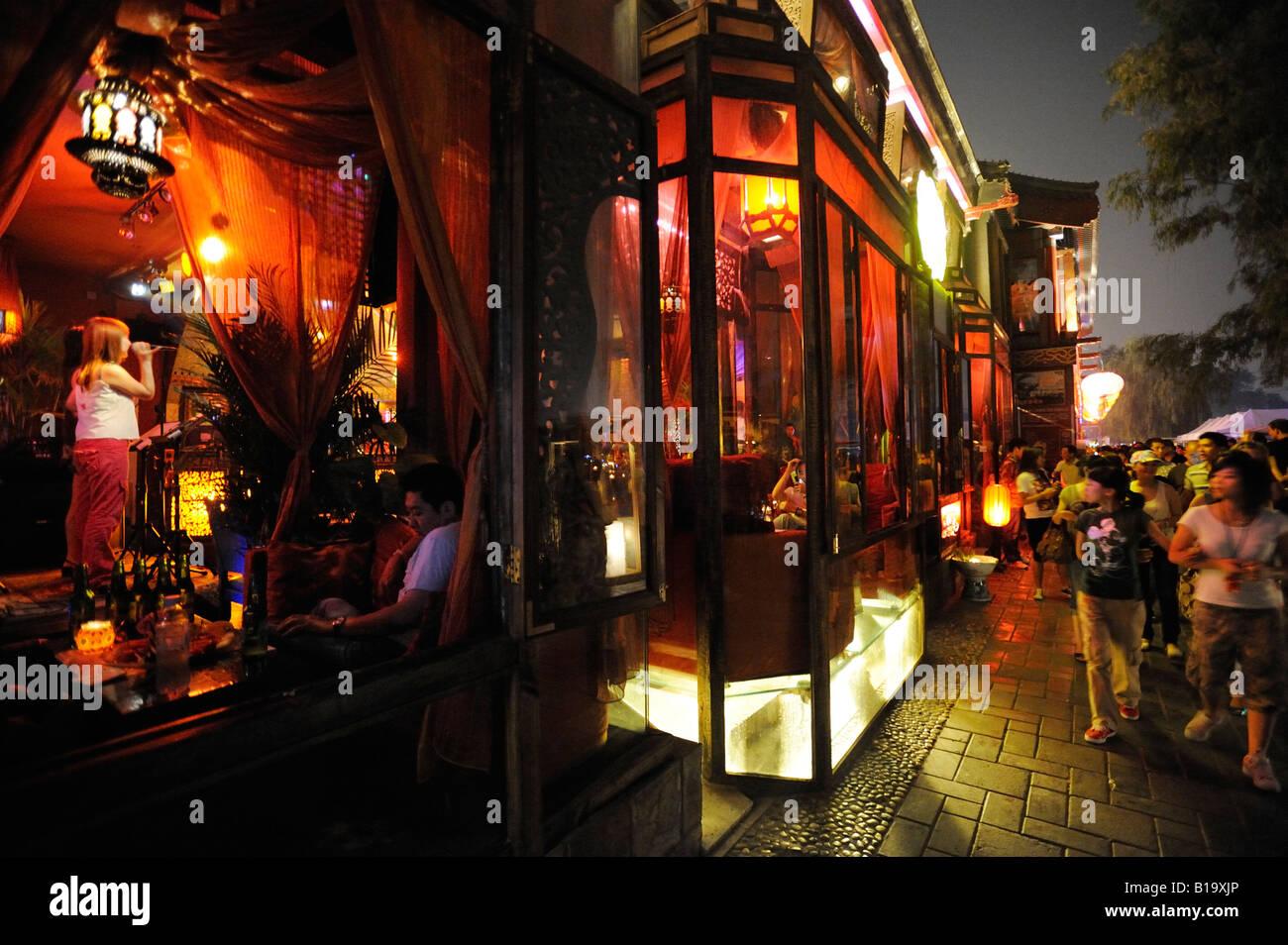 Tourists walk past a restaurant near Lake Houhai in Night Beijing China. 08-Jun-2008 - Stock Image