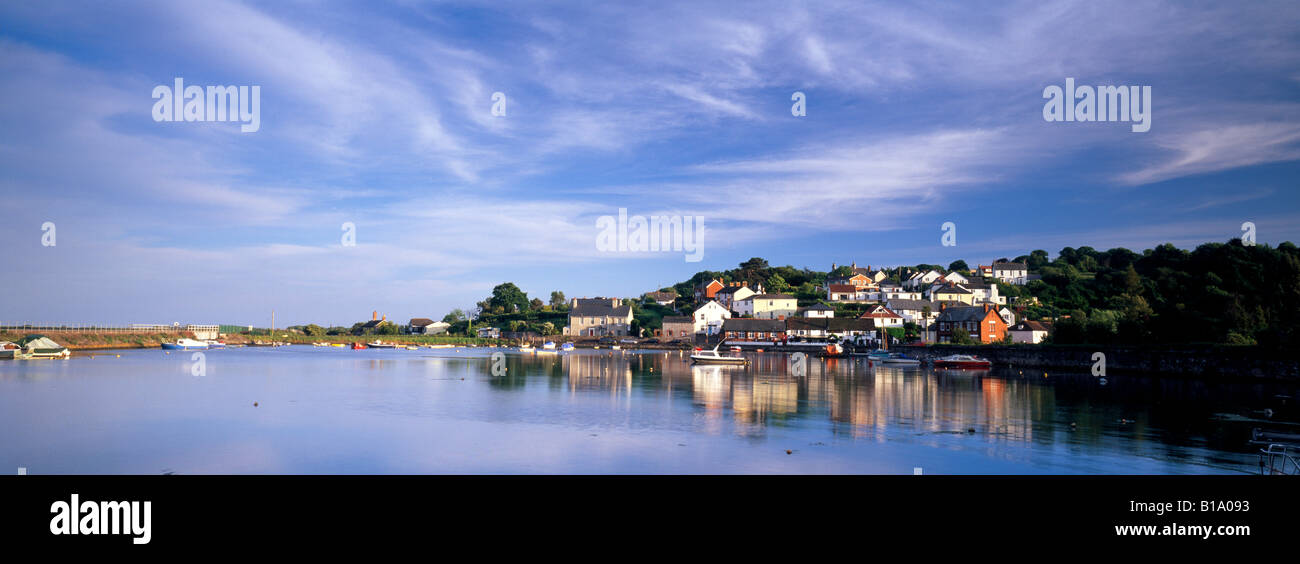 Beautiful panoramic view of Cockwood Harbour, Devon, UK, showing the village reflected in the water below striking - Stock Image