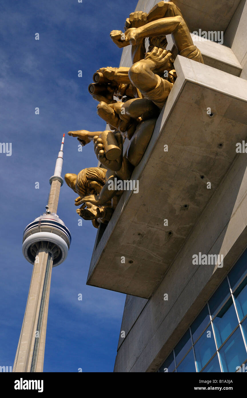 Spectator sculpture in box seats at Rogers Centre Skydome pointing to CN tower in Toronto - Stock Image