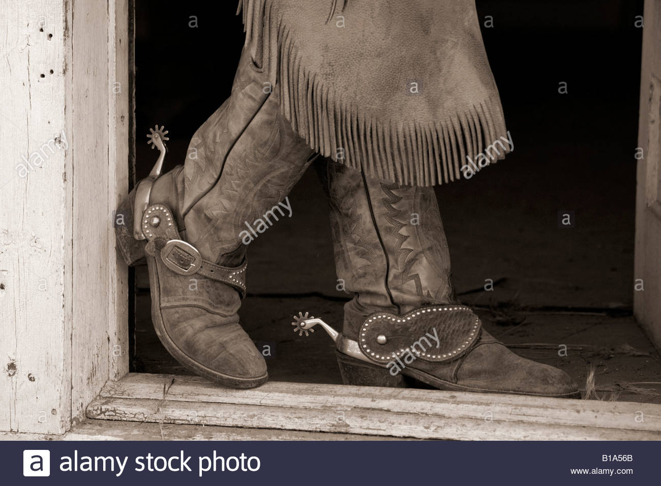 Cowboy Boot in Doorway, Wyoming - Stock Image