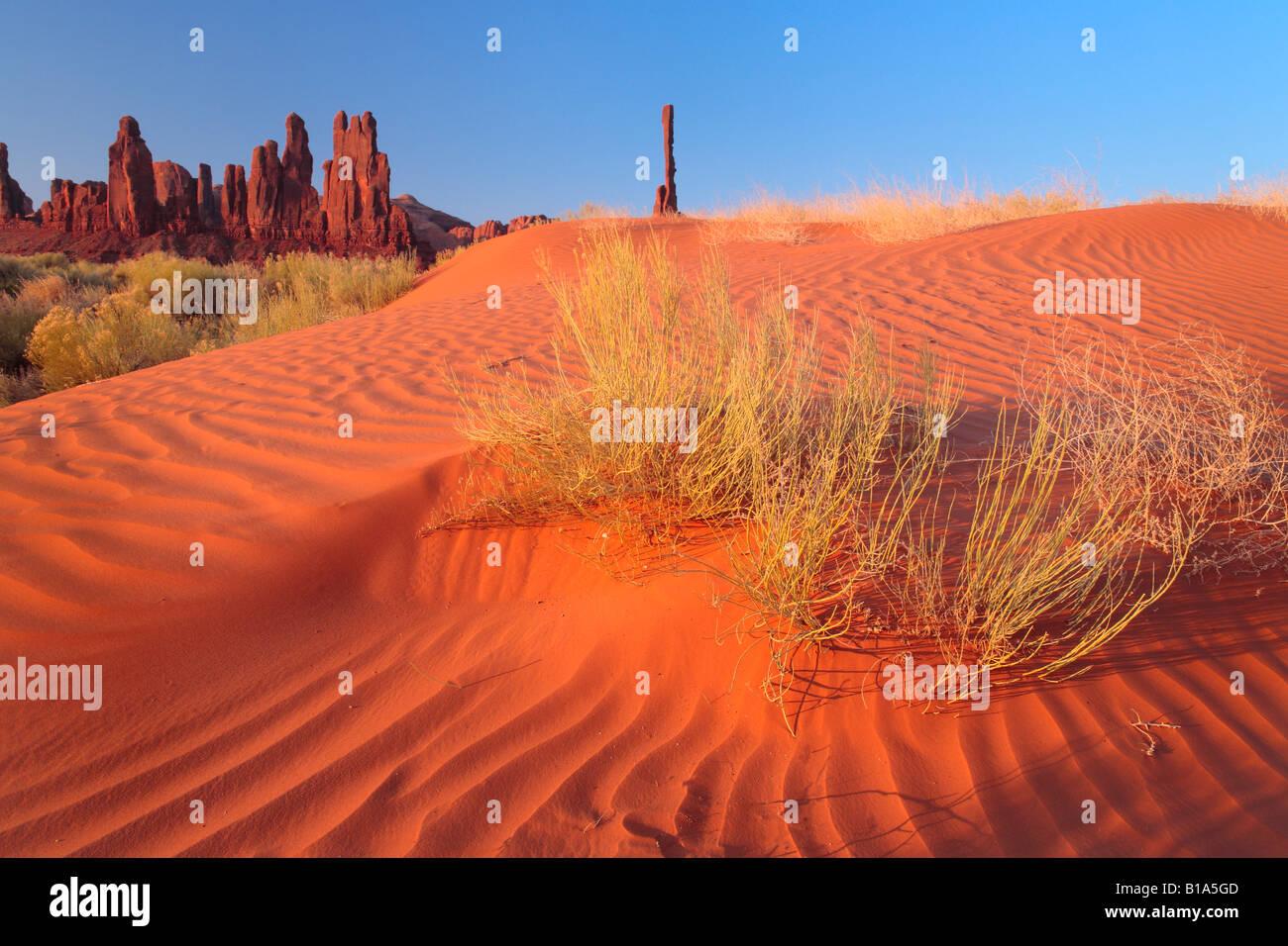 Sand dunes near Yei-bi-Chai rocks (Totem Poles) in Monument Valley, Arizona - Stock Image