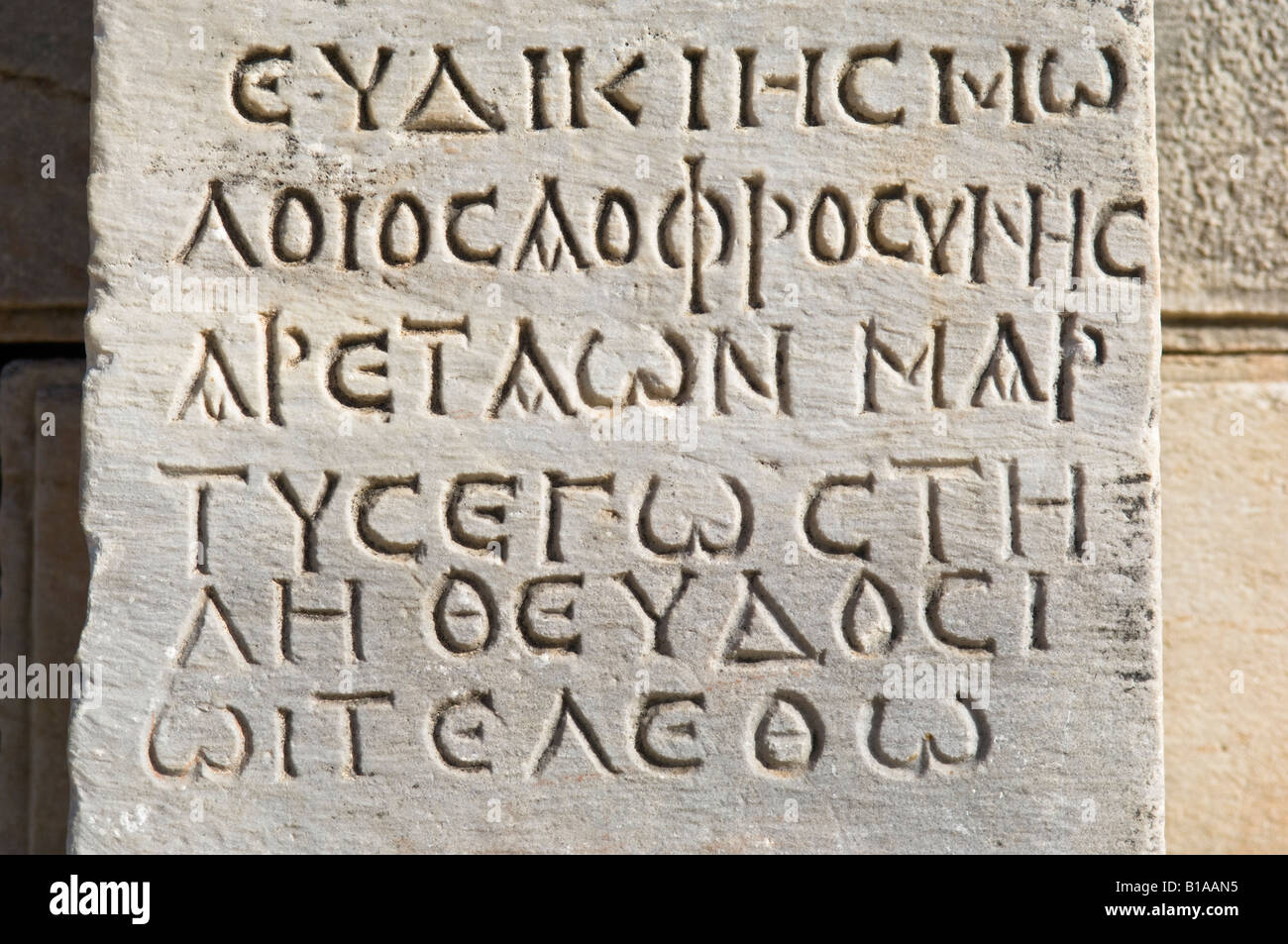 Close up photograph of Greek Inscription from the Hellenistic Period. Ancient City of Ephesus. - Stock Image