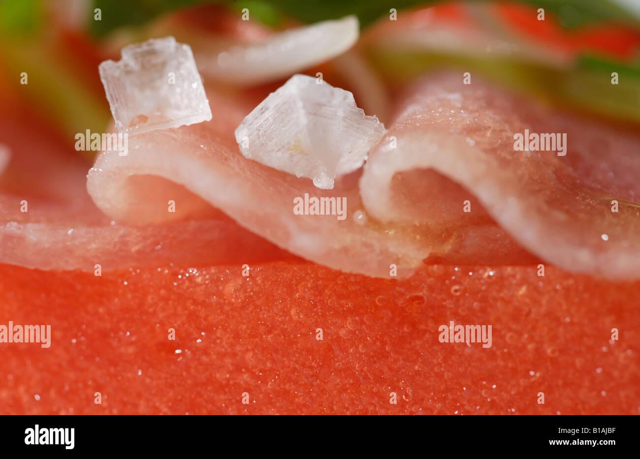 Tuna carpaccio over jellied tomato and rocket - Stock Image