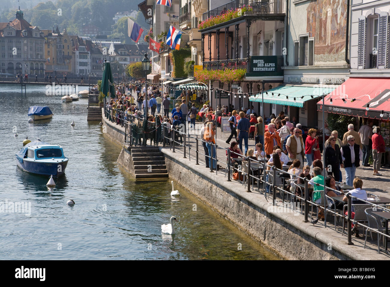 Switzterland, Lucerne, Reuss river, sidewalk cafes - Stock Image
