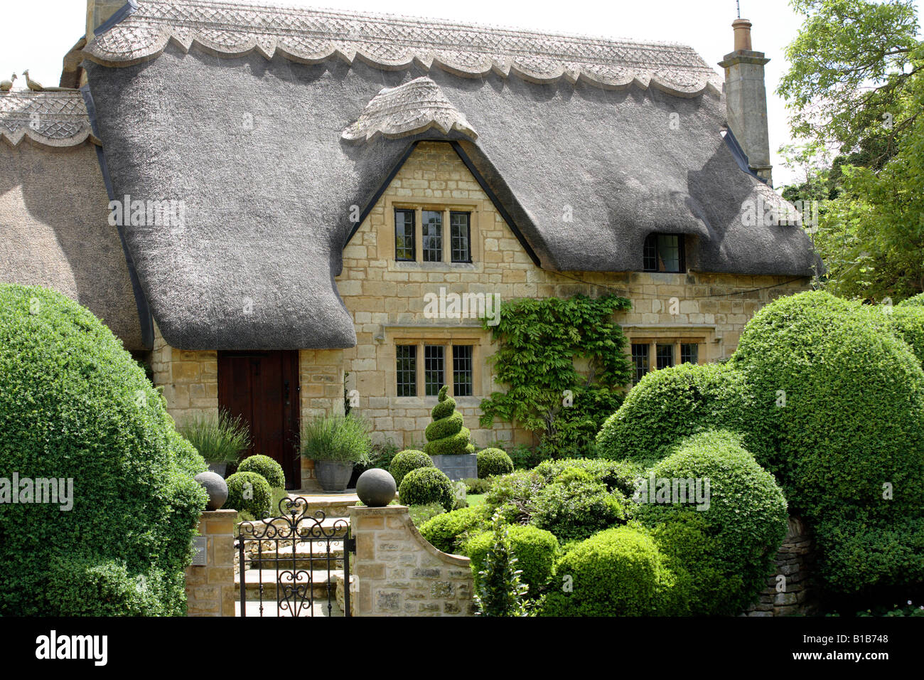 A Thatched Cottage In The Town Of Chipping Campden In