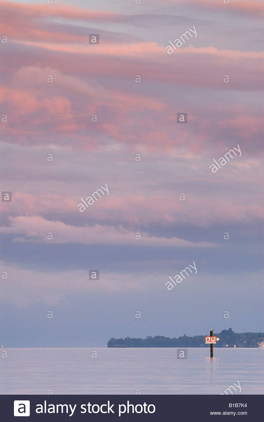 Germany, Bodensee, Sipplingen, sea mark in the afterglow - Stock Image