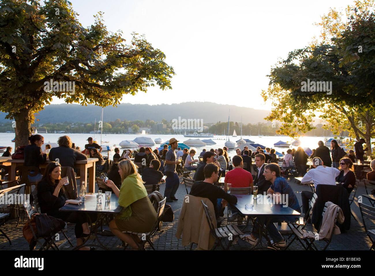 Switzerland, Zurich, Seefeldquai, beer garden and Lake Zurich - Stock Image