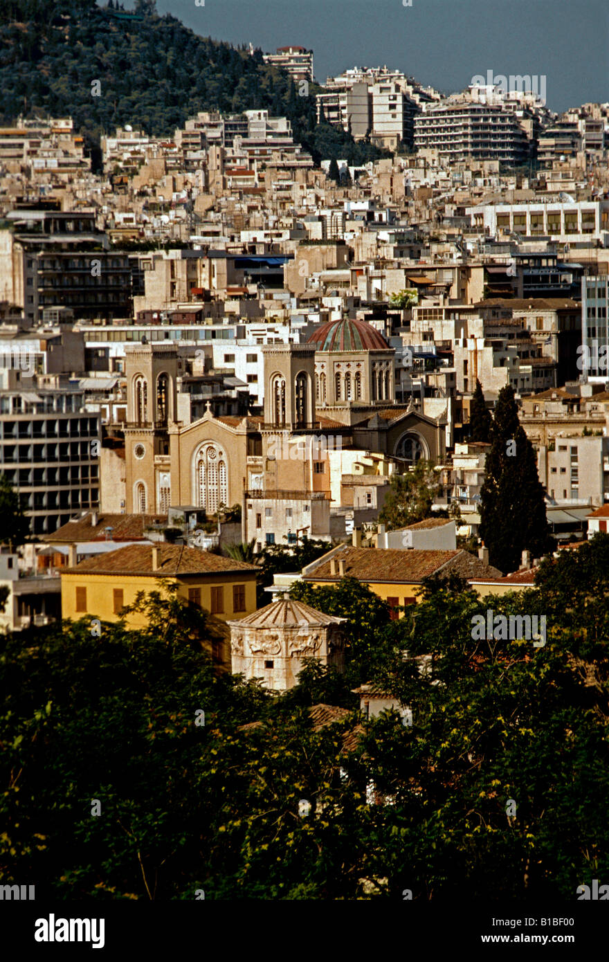 Architecture buildings structures homes houses along hill hillside Athens Attica Greece Europe - Stock Image