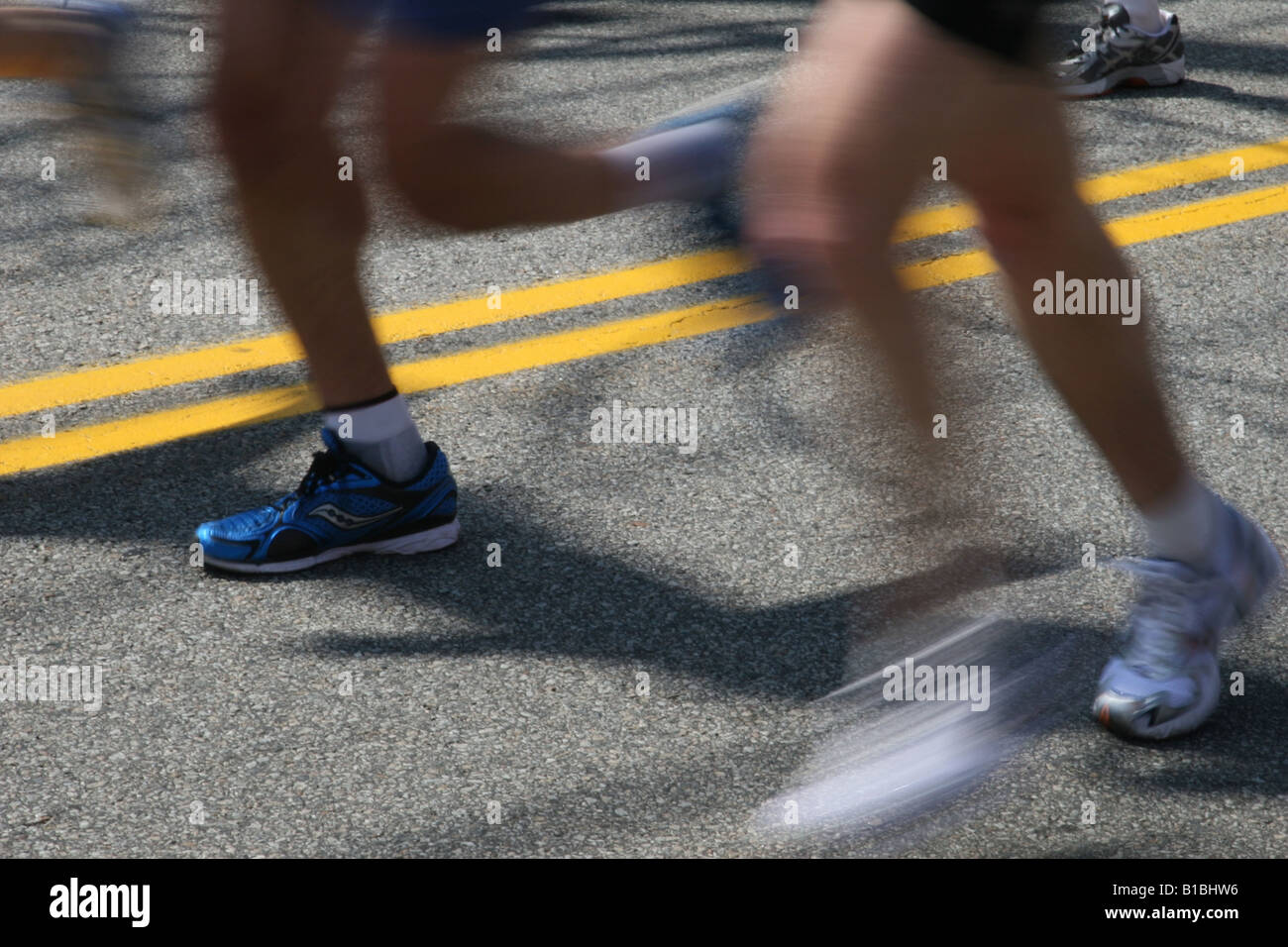 Runners legs at the 2008 Boston Marathon, motion blurred. 21 April 2008, Hopkinton, Massachusetts. - Stock Image