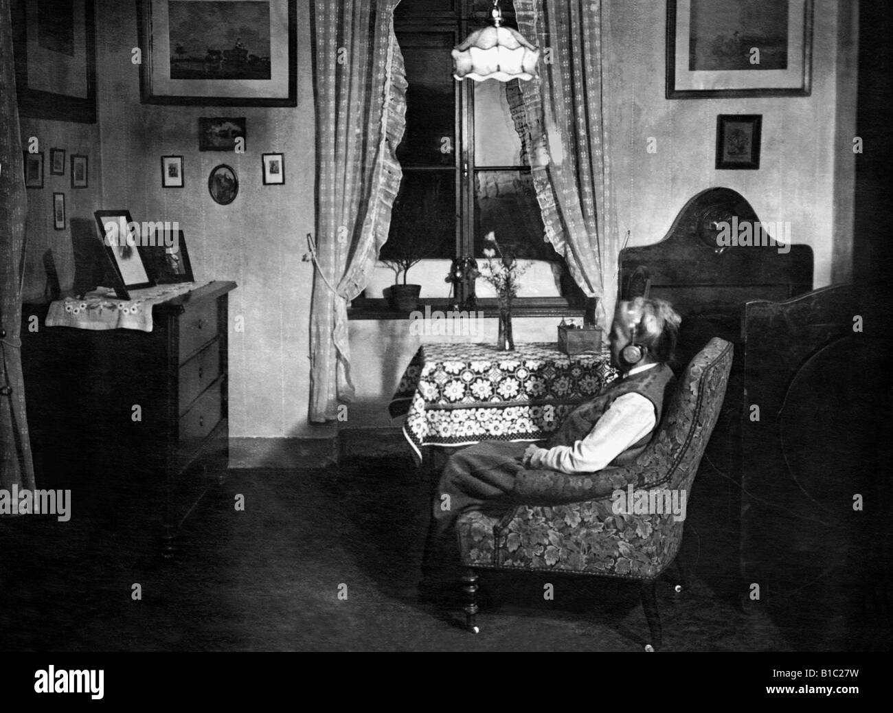 Woman Listening Radio 1920s Black And White Stock Photos Images