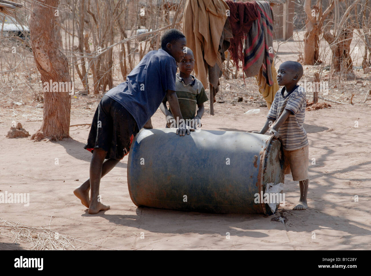 geography / travel, Zambia, people, children rolling water barrel in Tonga Village near Siavonga at Kariba reservoir, - Stock Image