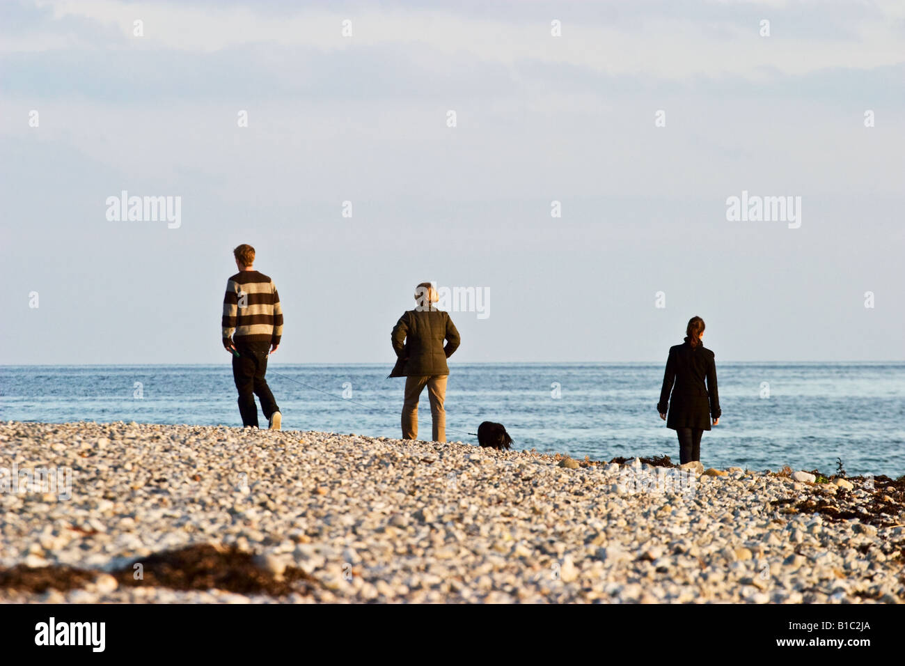 Walking on the beach - Stock Image