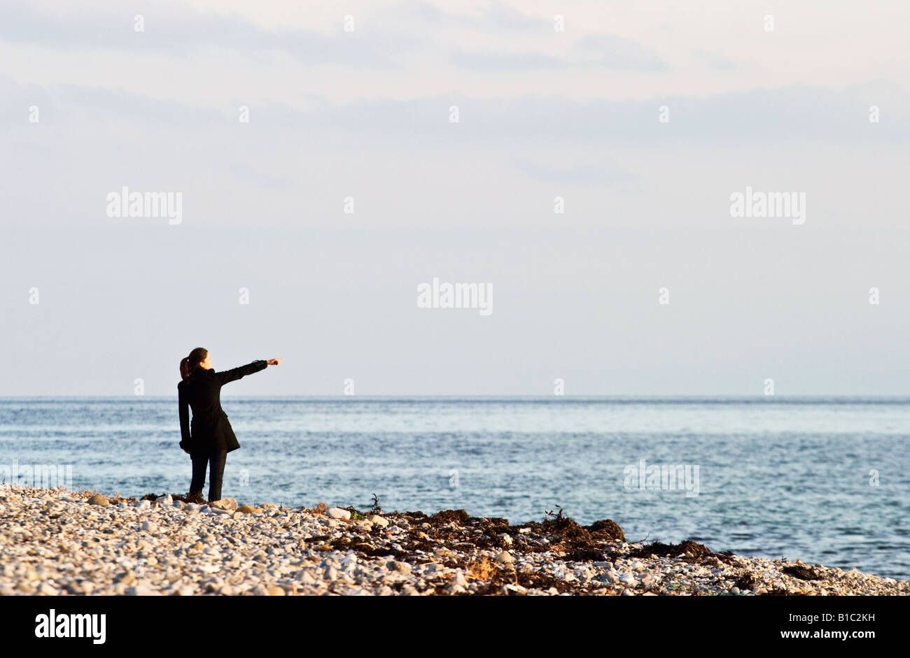 Women pointing at the sea wiev - Stock Image