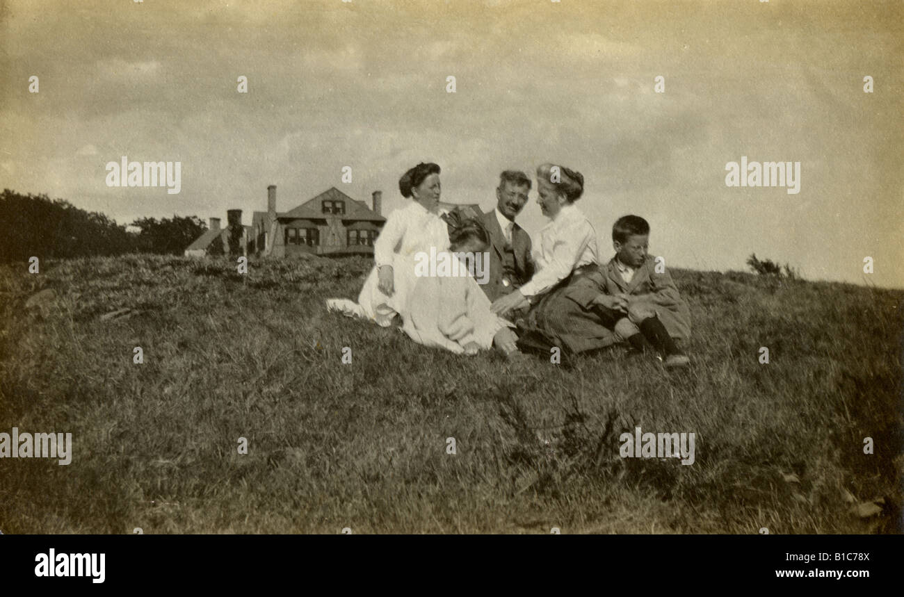 Antique photograph, circa 1890s, of a well-to-do family in front of their Victorian-era home in New England, USA. - Stock Image