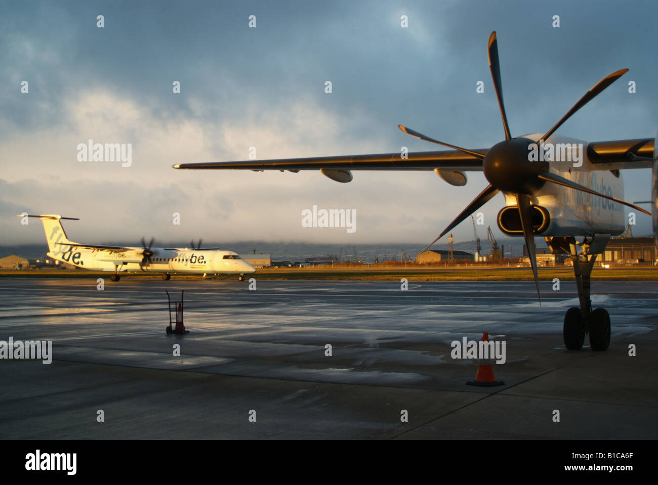 Flybe Dash 8 400 propeller aircraft on apron at Belfast City Airport N. Ireland - Stock Image