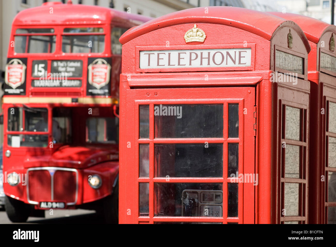 Red phone box and doubledecker bus. Fleet Street, London, England - Stock Image