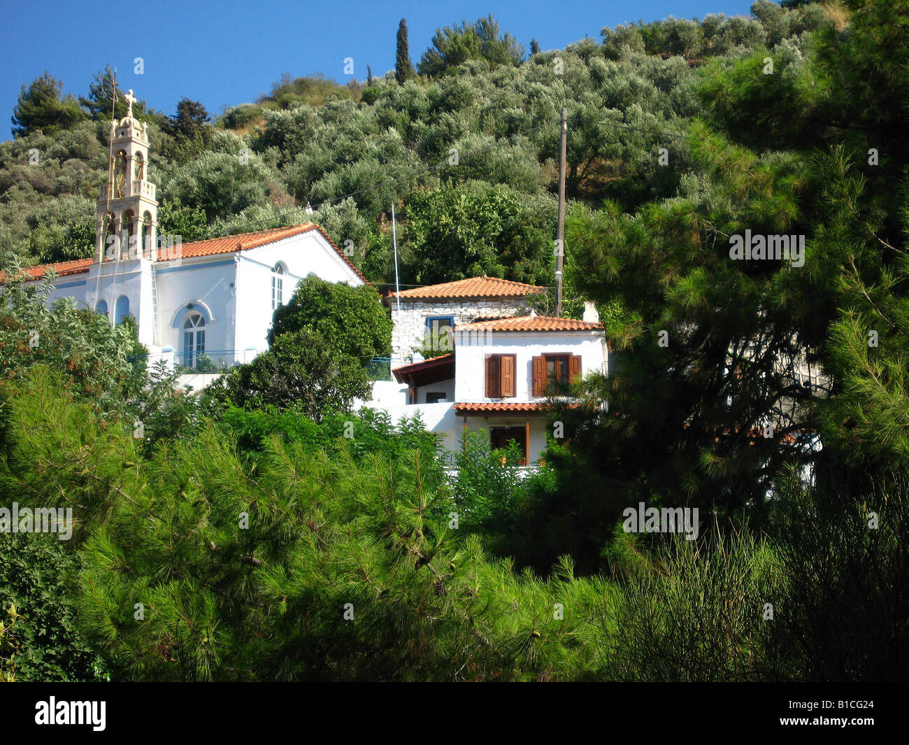 The church and houses of Ano Ag. Konstantinos on the island of Samos in Greece. - Stock Image