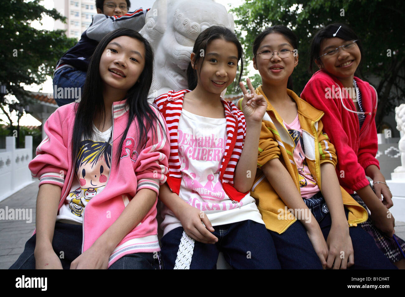 Young girls in a park between blocks of