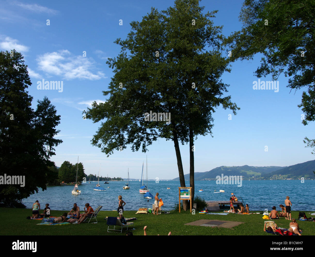 people in the sunbathing area at lake Attersee, Austria, Upper Austria, Attersee - Stock Image