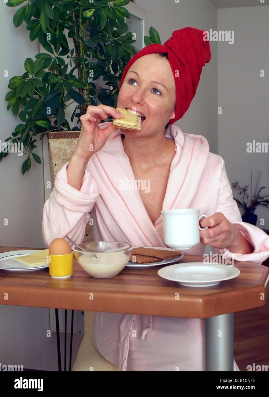 young woman at substantial breakfast - Stock Image