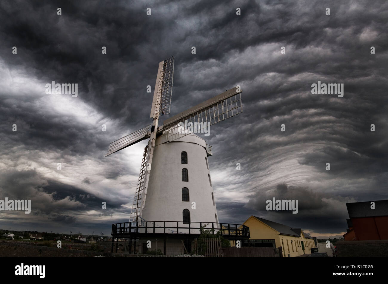 Gravity wave cloud formation behind Blennerville Windmill in Tralee. - Stock Image