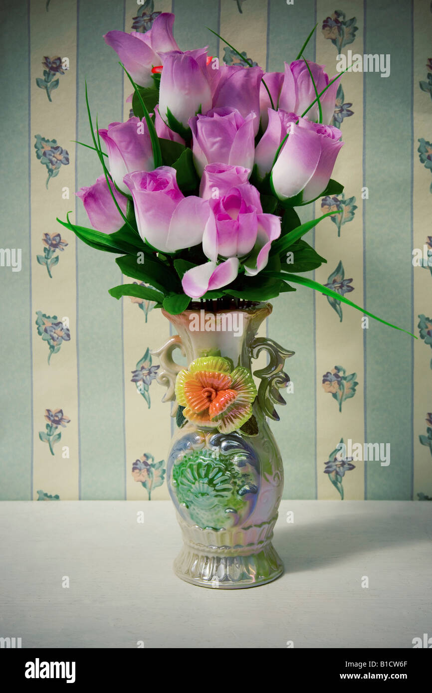 Kitsch Set Of Silk Flowers And Cheap China Vase Shot Against Stock