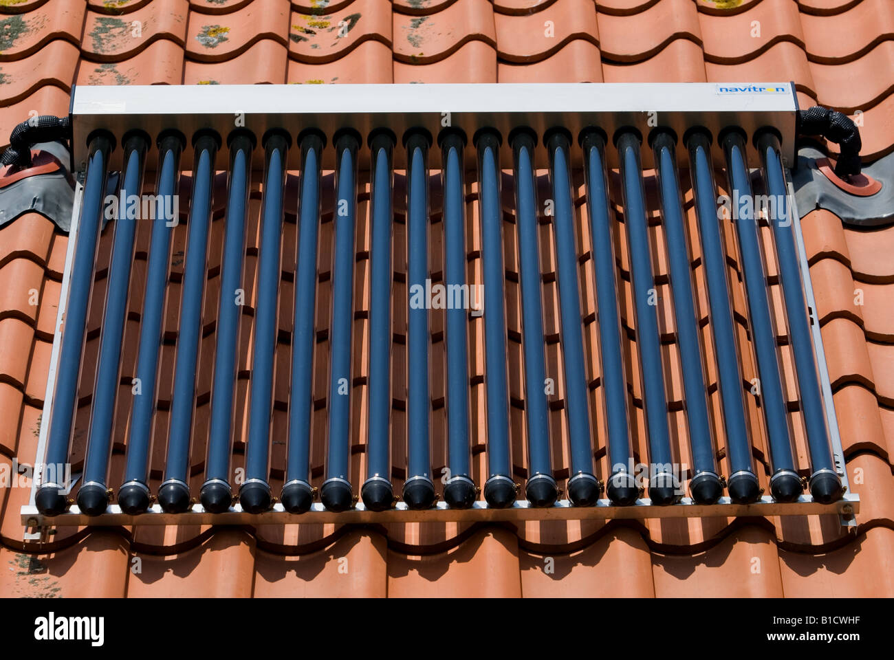 Solar evacuated tubes fitted on the roof of a house in Alderton, Suffolk, UK. - Stock Image