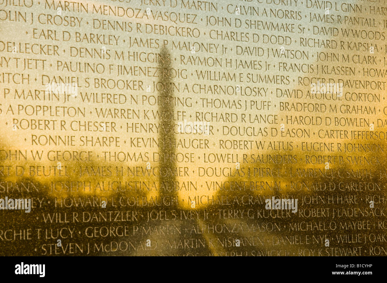 Reflection of the Washington Memorial on the Viet Nam Memorial at dawn - Stock Image