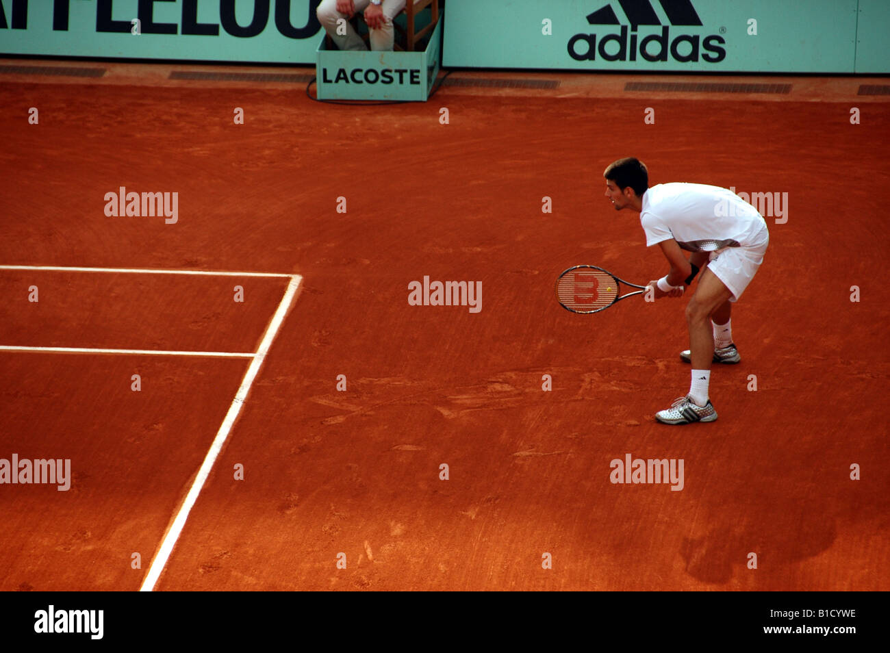 Novak Djokovic waiting to return serve at Rolland Garros during the 2008 French Open tennis tournament - Stock Image
