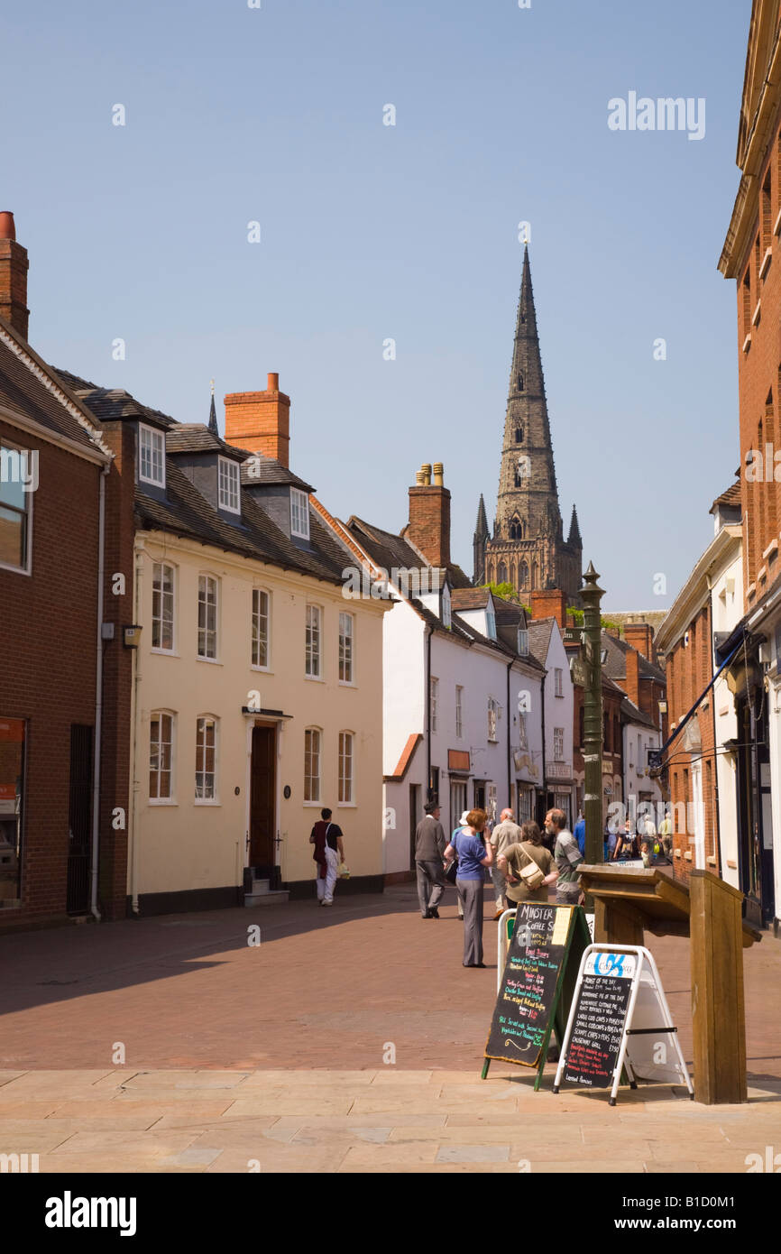 View along pedestrianised narrow street with historic buildings to cathedral spire. Dam Street Lichfield Staffordshire - Stock Image