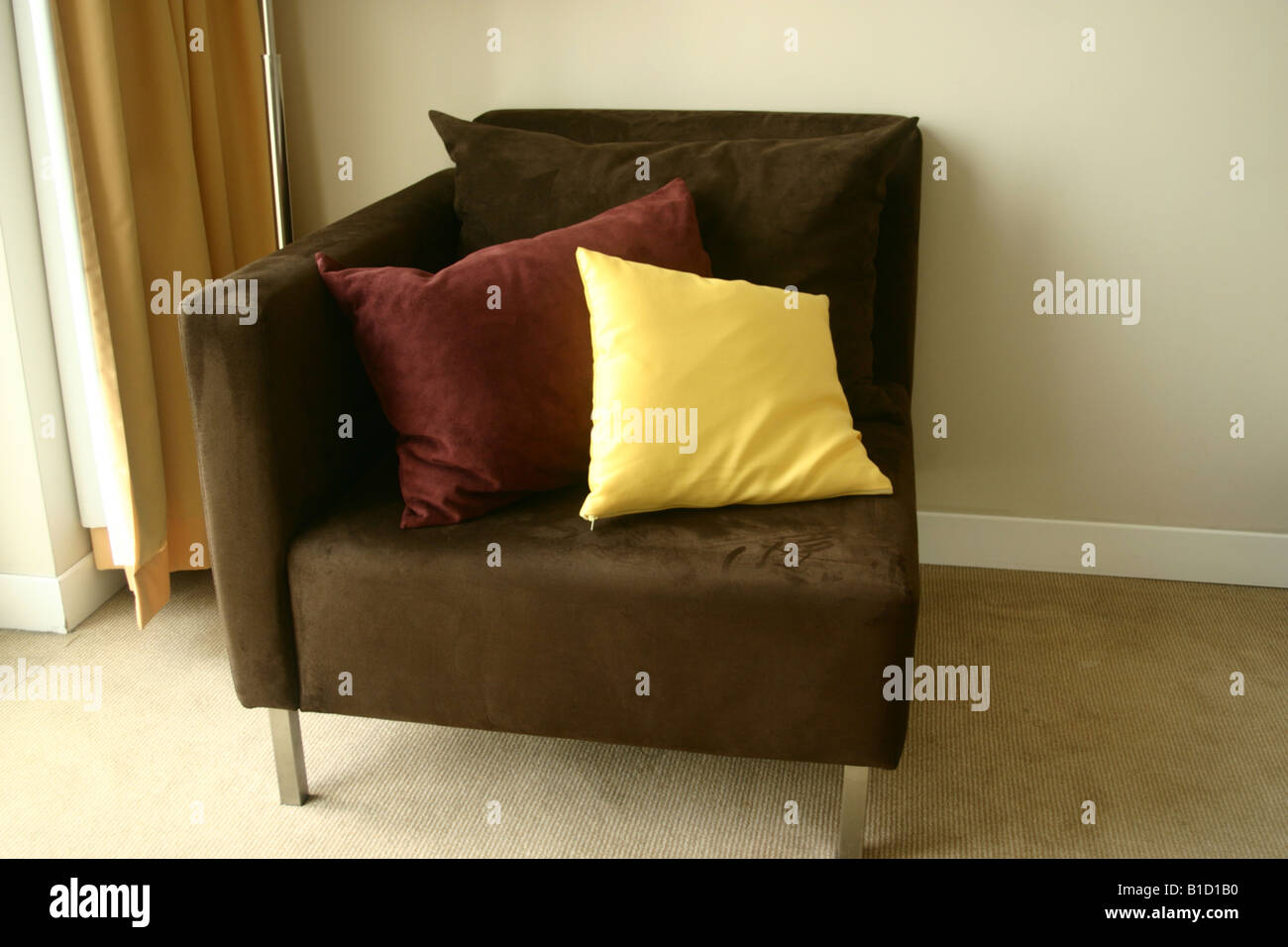 A comfy Chair in nice neutral colours. - Stock Image