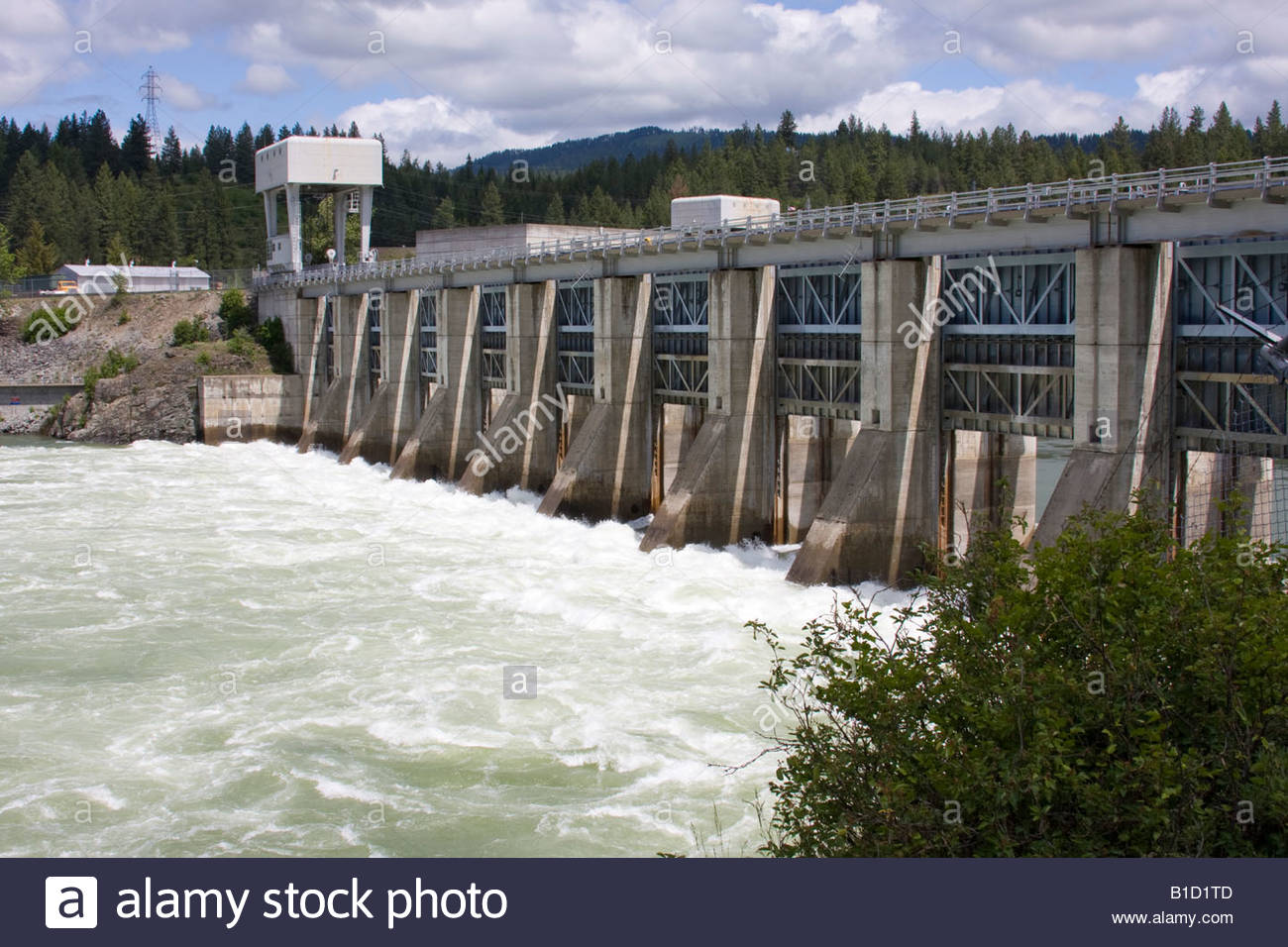 Water churning below the Albeni Falls Dam on the Pend Oreille River in North Idaho - Stock Image