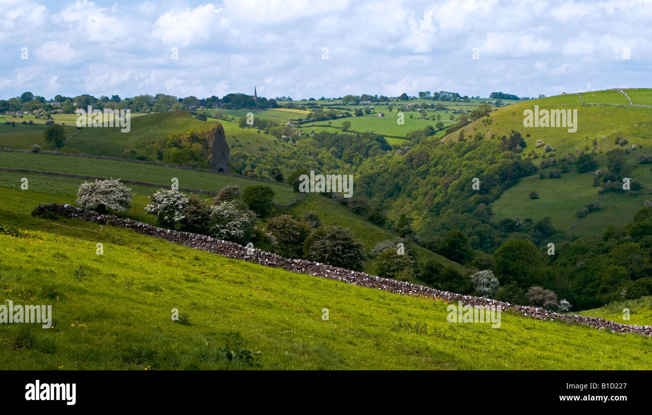 View looking over the Manifold Valley to the summit of the Thor's Cave crag in the Peak District National Park Staffordshire Stock Photo