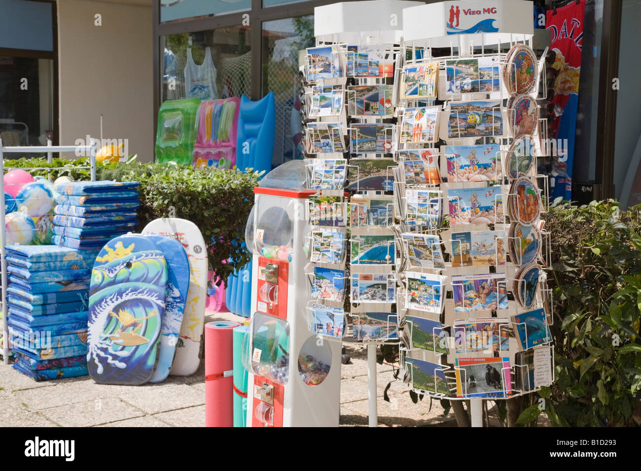 Croatia Europe. Shop selling postcards on display stand outside and seaside goods - Stock Image