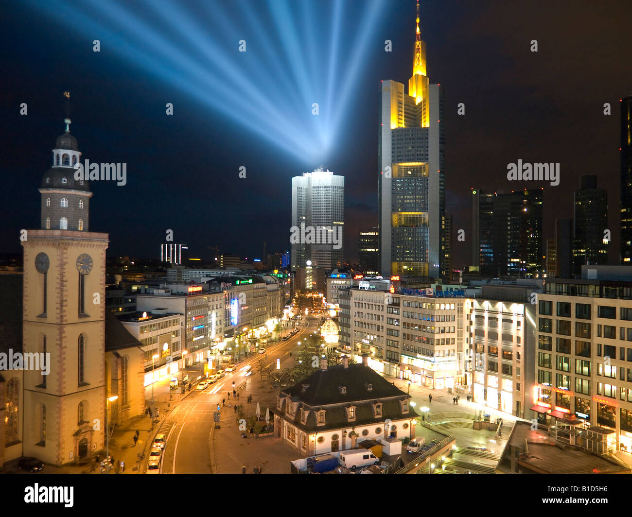 skyline of Frankfurt in the night view over Hauptwache main guard to west beams of light and colourful lightened Stock Photo