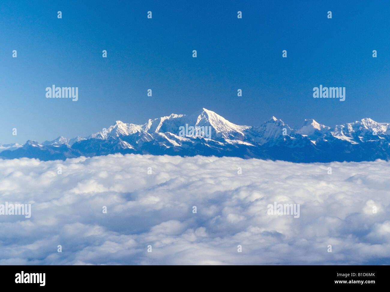 Kings of the Himalaya mountain range, Nuptse, Mount Everest and Lhotse, with blanket of clouds below - Stock Image