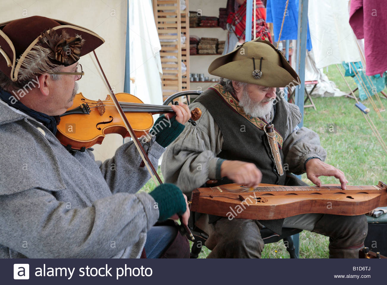 Period musicians play at a sutler's booth at the Market Fair at an