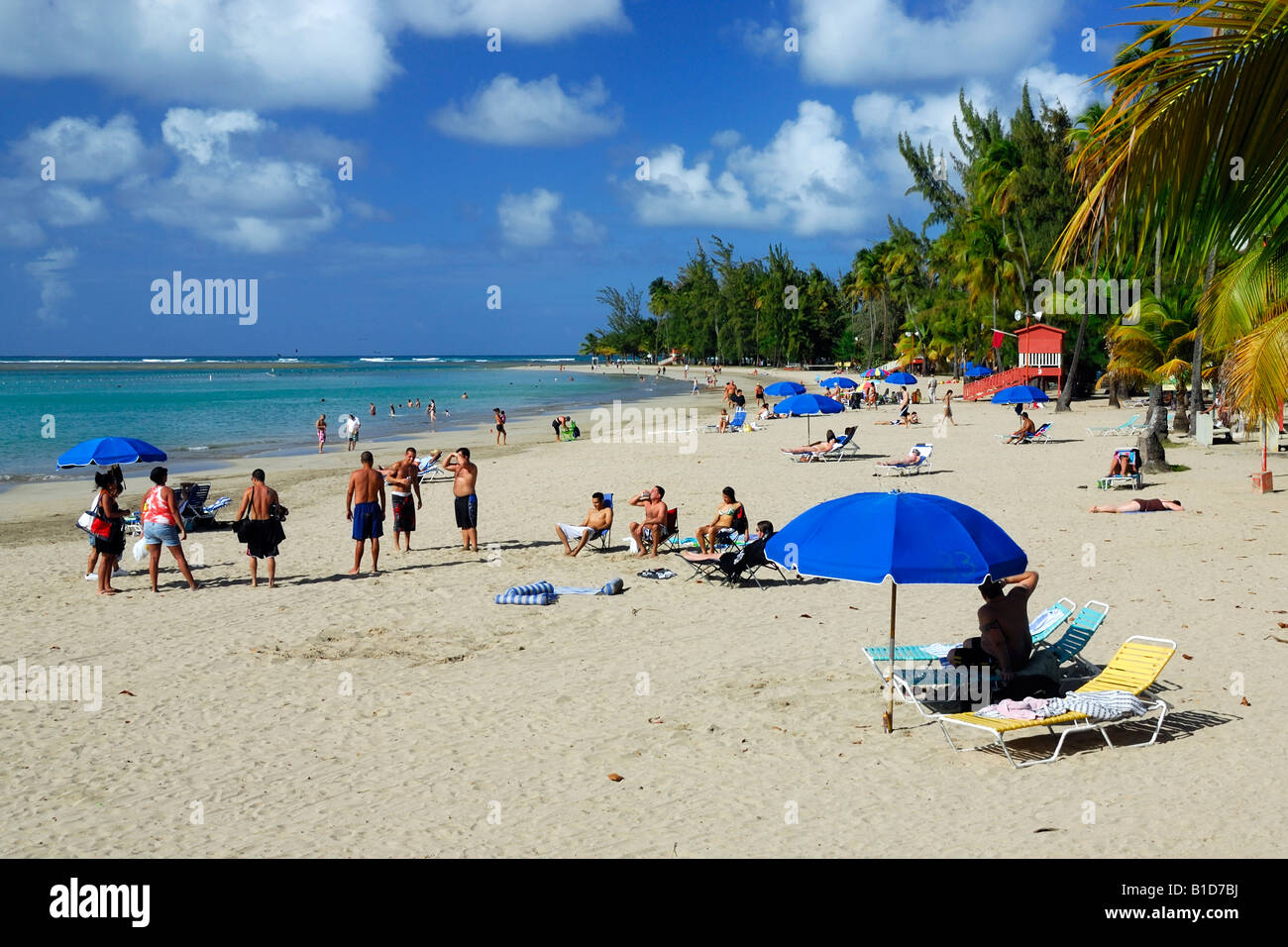 People Enjoy A Beautiful Afternoon At The Luquillo Beach Balneario
