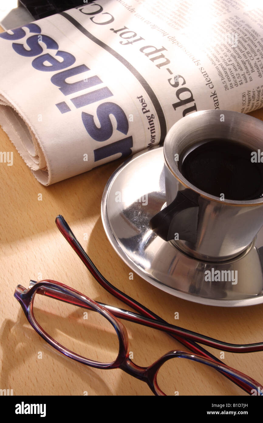 Black Coffee Newspaper and Glasses on Desk Stock Photo